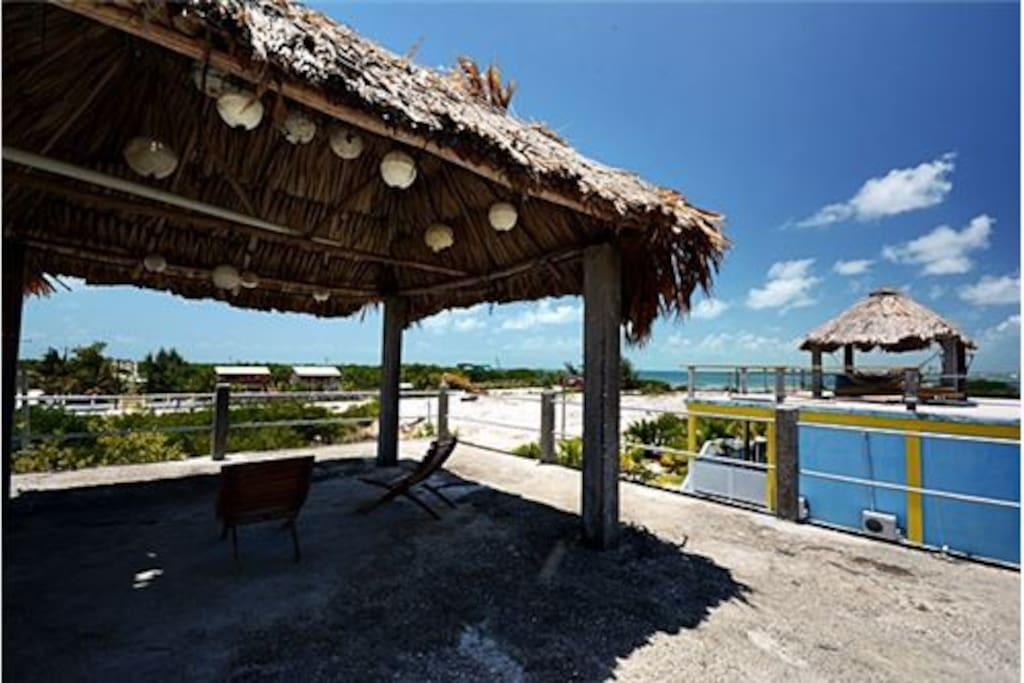 Roof top has palapa and great views of sea and sunset