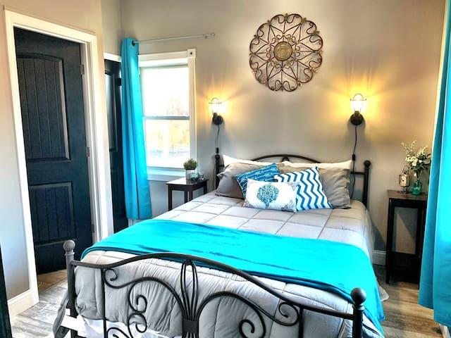 Bedroom with queen sized, premium memory foam mattress, closet, full bath.