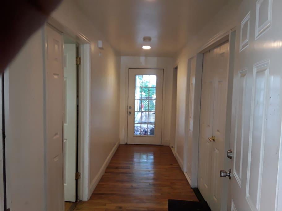 Entrance hallway. Apt is through door to the left.