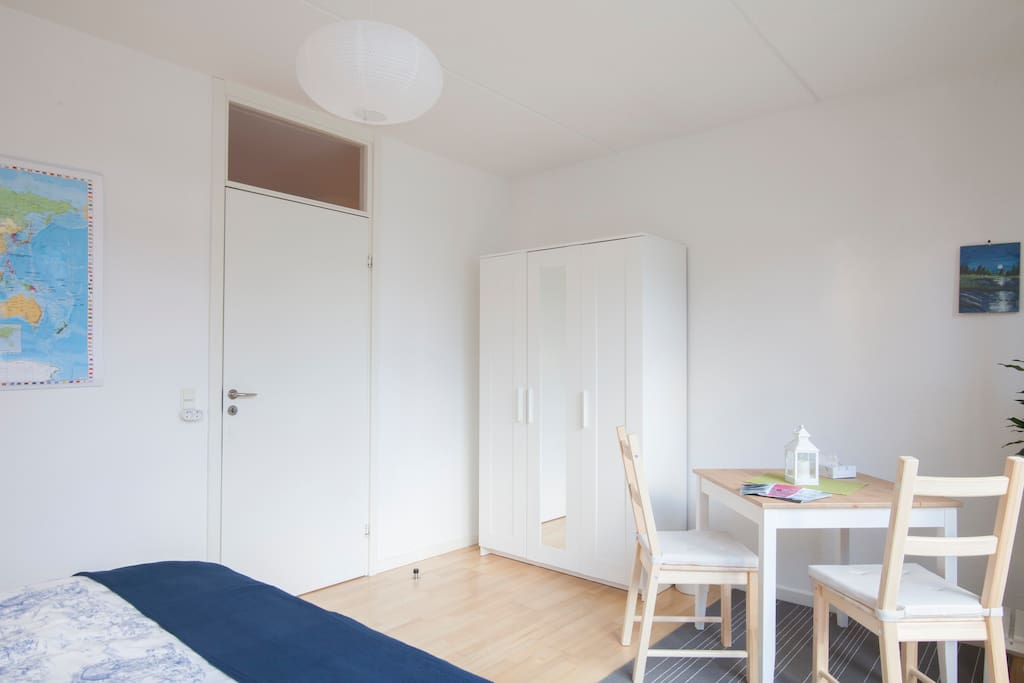 Your own wardrobe with your towels, extra blanket and a first aid kit.  The cosy table in the corner can be used for private dining or laptop work.