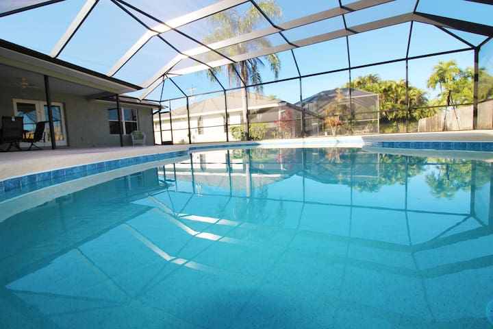 2 master suites and a new heated pool. Spacious pool deck. Villa Cape Escape