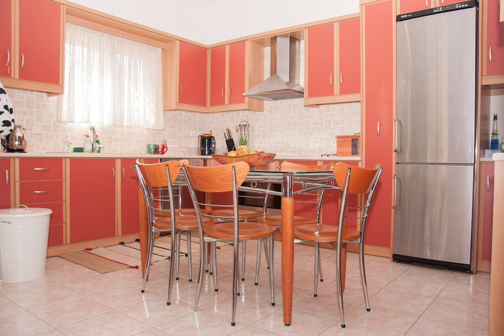 This is the kitchen with a dining table