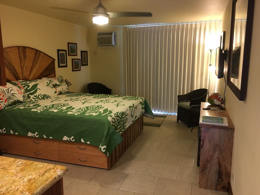Black out curtains, air-conditioning, king bed with storage.