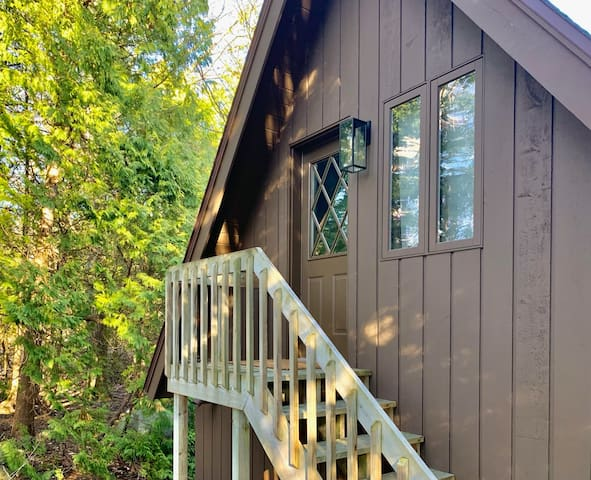 Over the garage and through the woods: another bedroom and bathroom.