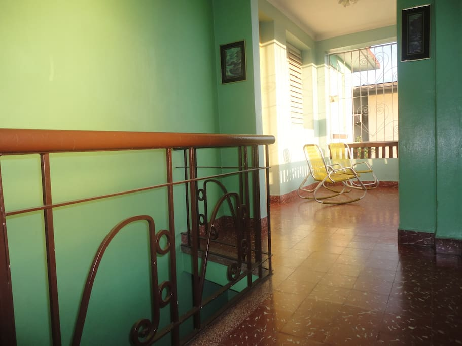 Entrance to the house and the balcony (common area).