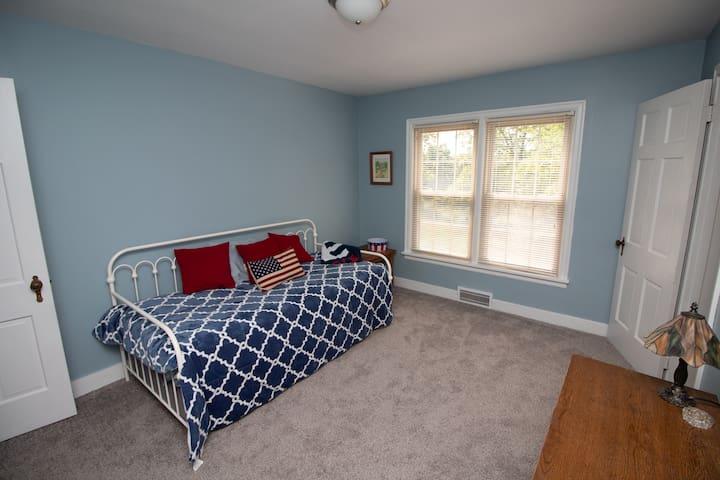 Bedroom with twin trundle bed (sleeps 2) & desk.
