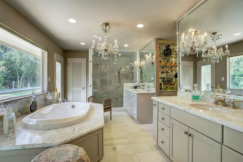 Master bath with a Huge 2 person shower and view  of backyard and private patio