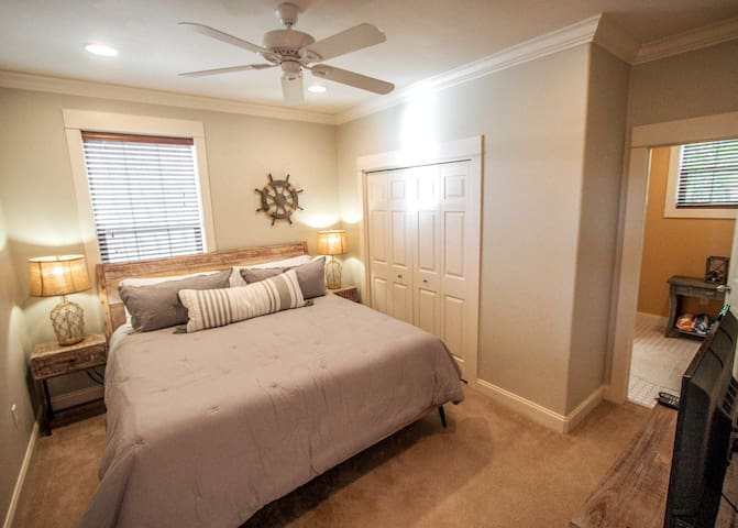 The third floor features its own private primary bedroom with a king-sized bed and ensuite shower.