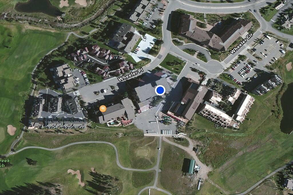 Blue dot indicates location of condo.