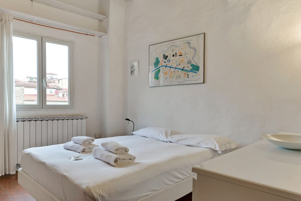 The Bedroom - The comfortable double bed with soft bed-linen and towels