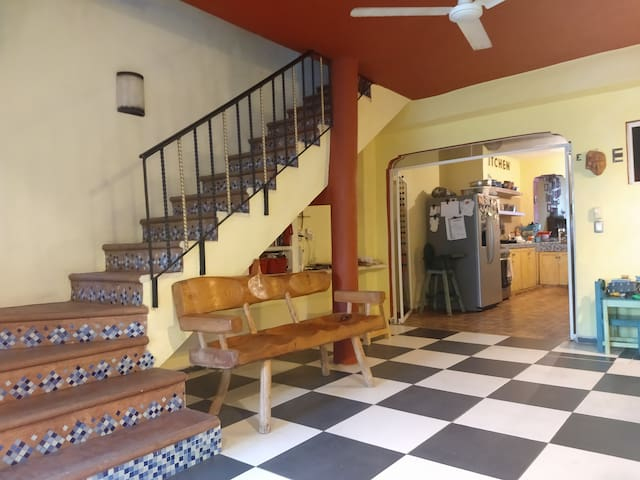 """We built around the original exterior staircase to create a family room space with plenty of light and fresh air from the garden.   """"It's difficult not to gush about our stay at Casa Misterio. Thanks guys, for our best stay in Mexico!"""" --Tri"""