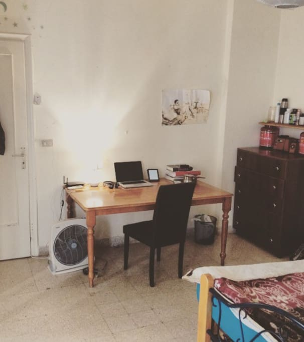 Massive desk and private work space in bedroom