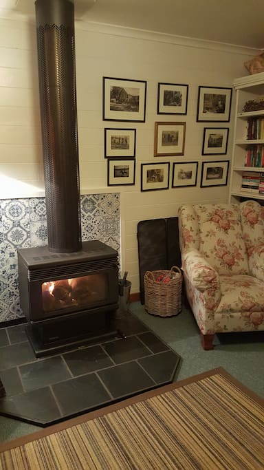 Lounge on a winters evening, with small library of books, magazines and games