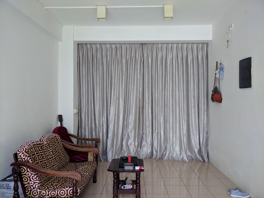 The curtain separates the living area and the bedroom
