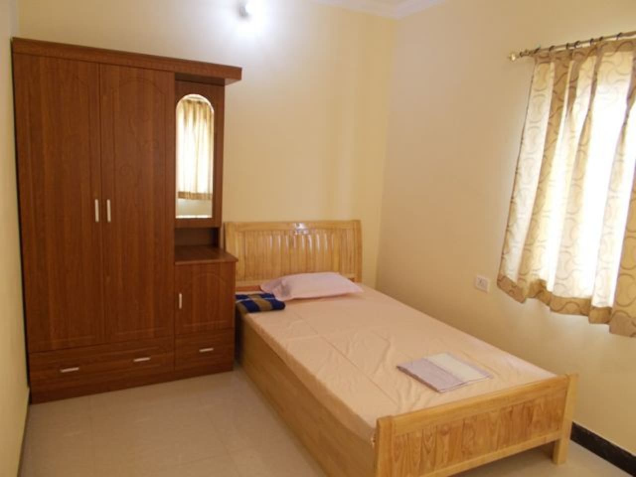 Ventilated furnished Bedroom with wardrobe.