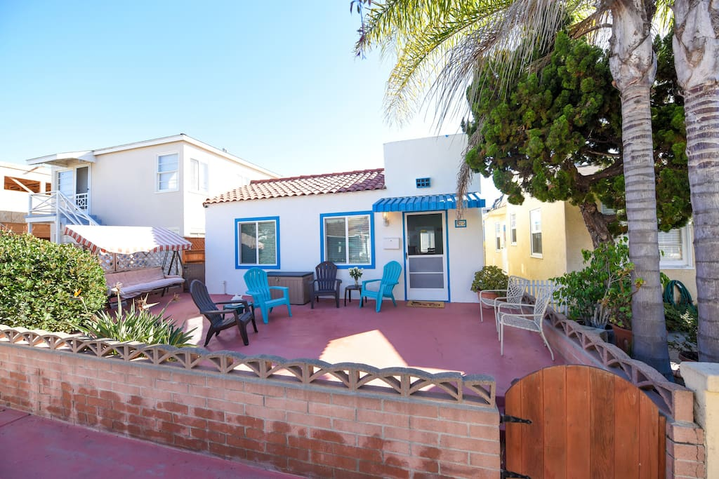 """Spanish style beach house steps to ocean and bay on cozy Mission Beach court. """"This place was actually better in person than the pictures indicated. It exceeded our expectations."""" - Ben (guest)"""