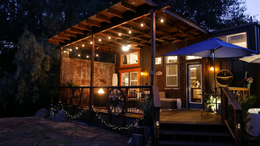 Tiny House on Wheels (just like the TV shows) with a huge deck to add another layer of living space