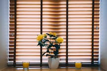 Large window with wooden blinds for full privacy