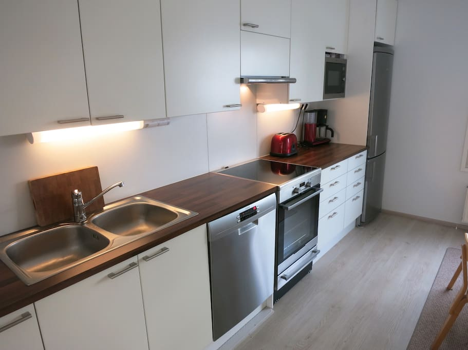 Kitchen has all the modern appliances available such as toaster, coffee machine, stove, oven, fridge, freezer and all the cutleries and other cooking equipment. There is a Artek-design table and chairs for 6 people to have a dinner in the kitchen.