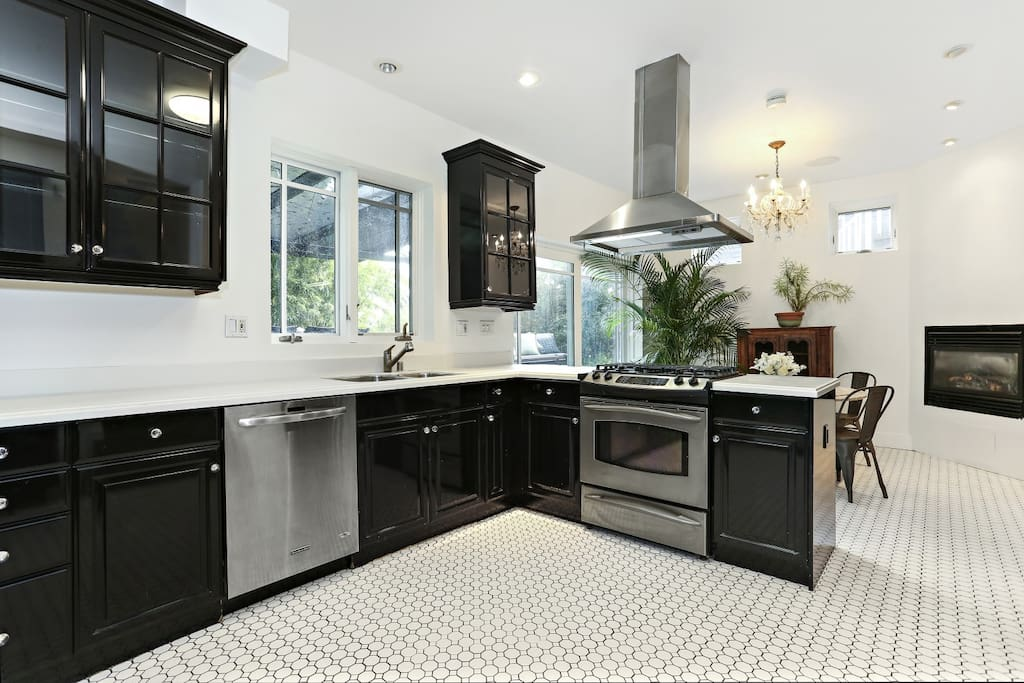 Gourmet kitchen open floor plan, access to private patio and huge,landscaped yard