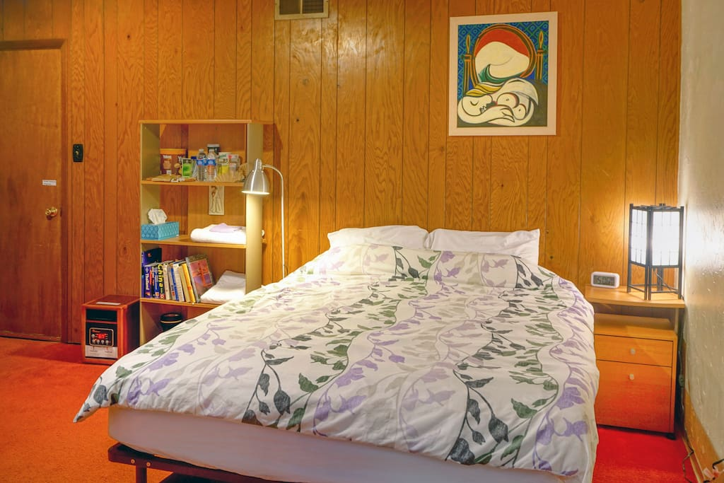 Queen size bed with comfortable mattress.