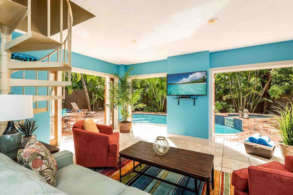 Brightly colored living room of an Airbnb Key West beach listing