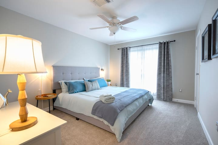 Bedroom includes king size bed and room darkening curtains for a good sleep anytime