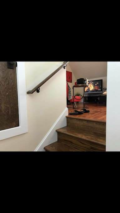 Stairs up to living area with tv