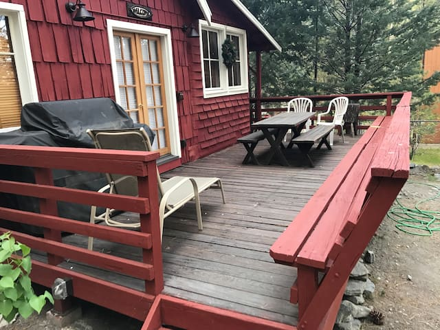 Patio deck with gas barbecue, dining table and plenty of seating