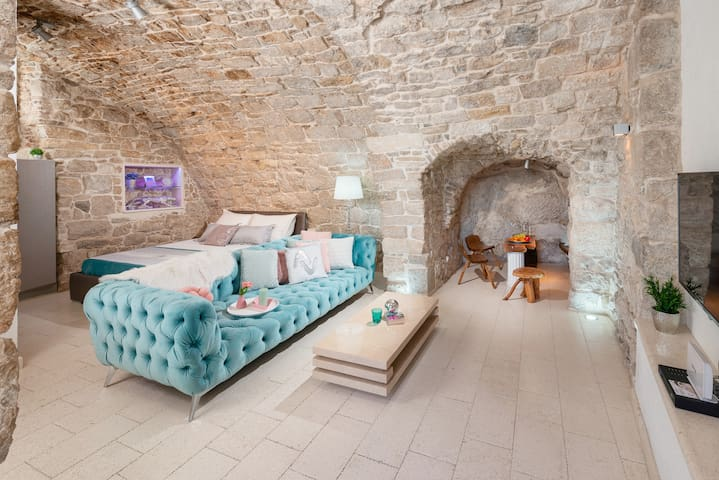 The whole apartment is surrounded by original stone walls, so during your stay you will feel like you are in cave ( the one from fairy tale).  Also, if you are visting Split during the hot summer days,  natural cold of the stone will cool you down.