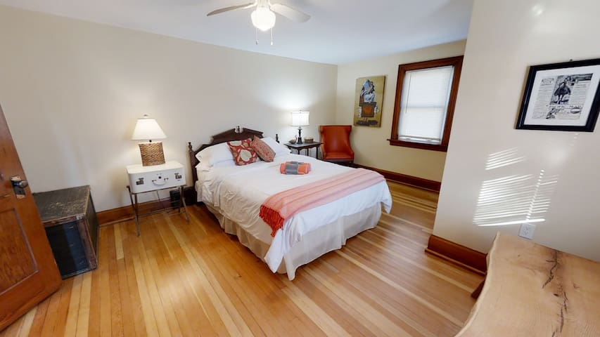 The largest of the bedrooms and features a queen size bed . It as refinished  hardwood floors, a closest, a live edge bench and a dresser.  Two windows allow for lake breezes.