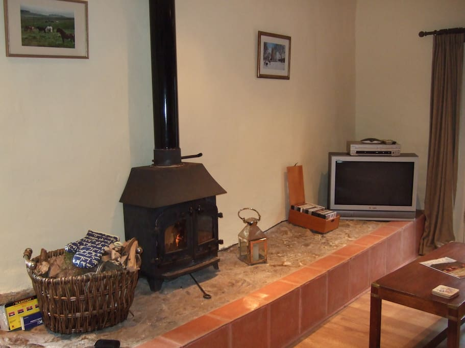 Snuggle up next to the wood burner with a glass of wine