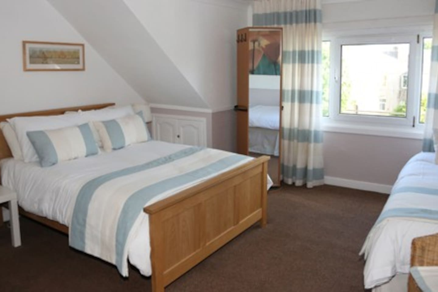 Room 1 - 1 Double, 2 Singles Beds and ensuite Shower room