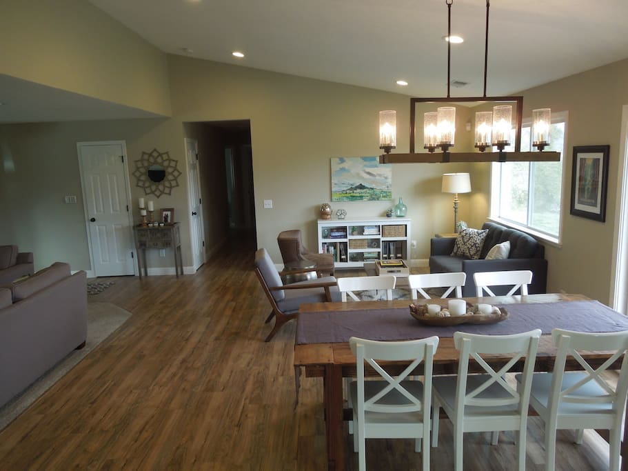 The front room has an open floor plan which includes the living room, dining areas, kitchen, and reading nook. Large windows and french doors provide beautiful views from every angle.
