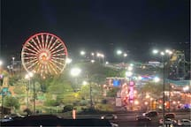 Night view out front door of Jolly Rogers Amusement park (zoomed)