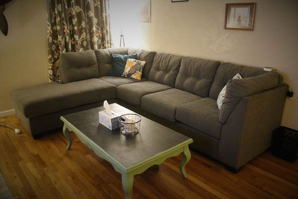 Sectional couch with chaise lounge in upstairs living room.