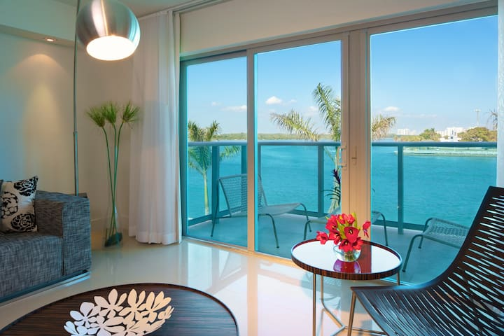 Two bedroom water view steps from the beach