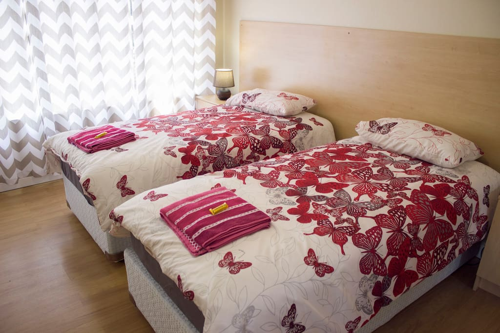 Room 1 - Flat screen TV, Selected DStv Channels, Fridge, WiFi, Spacious Room. These rooms are equipped with 2 single beds or a double bed.