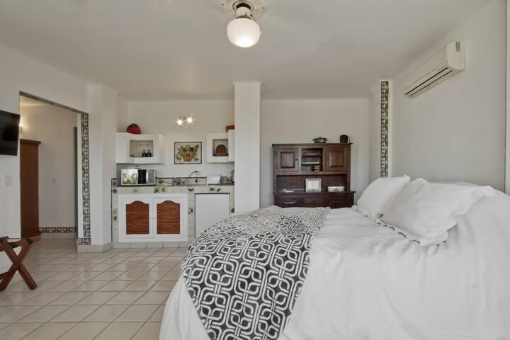 Queen-size bed, kitchenette, kitchen hutch  smart TV. With Netflix