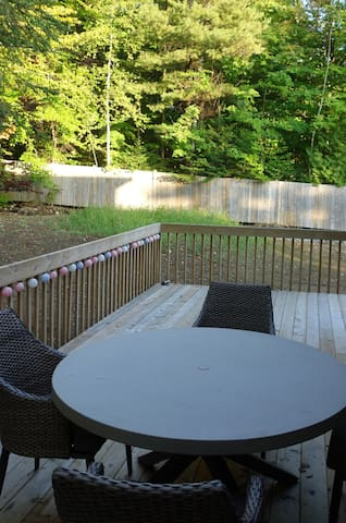 Patio table looking out to side of property. Note fence is no longer there, the property is not fenced.