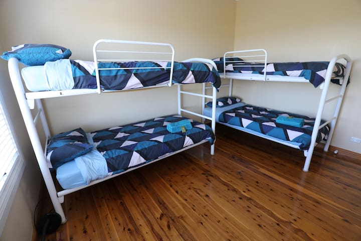 Bunkroom with four single beds (infant cot can be set up on request)