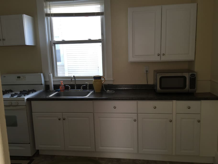 Gas stove, microwave, toaster fridge/freezer with all items to cook a home cooked meal