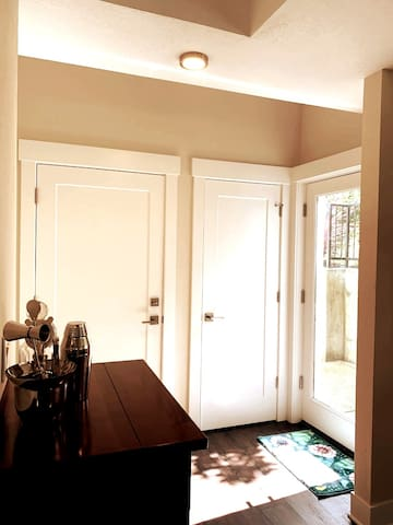 Behind the door on the left is a hallway and staircase that leads to the second unit. This door remains locked.  The central door is a large closet that goes underneath the stairs.   The door to the right is the private entrance.