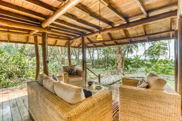 Tropical Beachfront Hacienda w/ lanai - steps from Pacific beach!