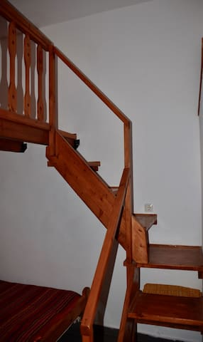 The wooden stairs to the Onda double bed in Despoina-bedroom.