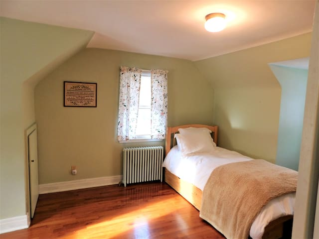 Second floor bedroom with desk.