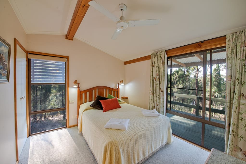 One of the three en-suite bedrooms with a queen bed.