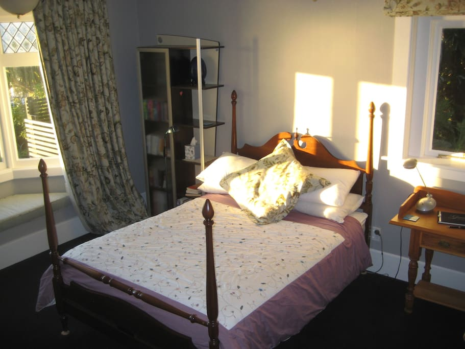 Guest double bedroom, afternoon sun streaming in