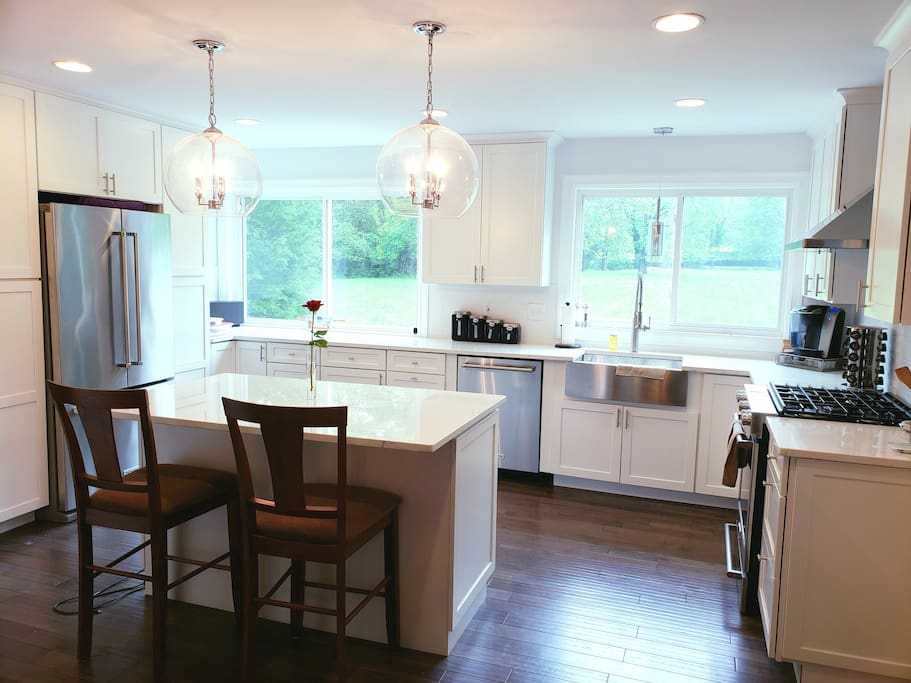 Kitchen with plenty of natural light opens to the large 2 acre yard