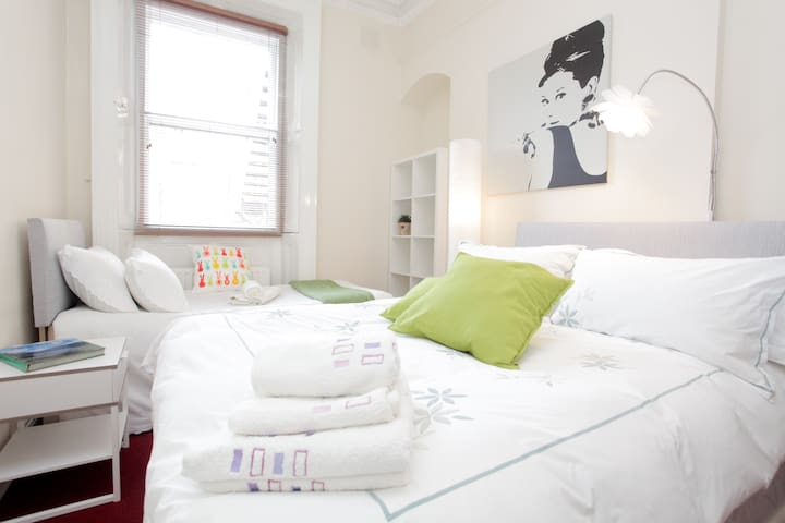 Each bedroom contains a double and single bed.